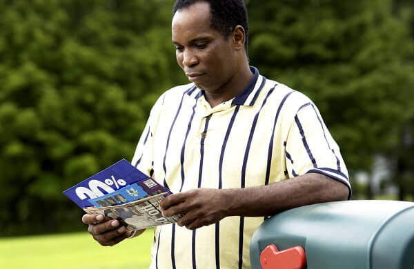 man reading marketing newsletters