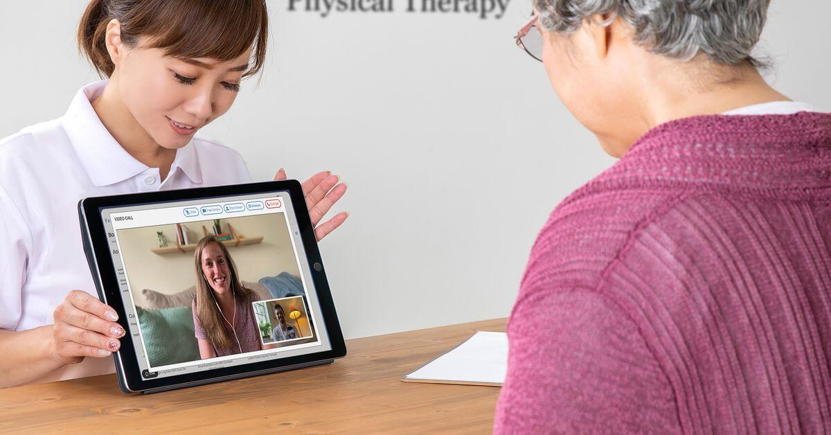 Staff Explaining Telehealth To Patient